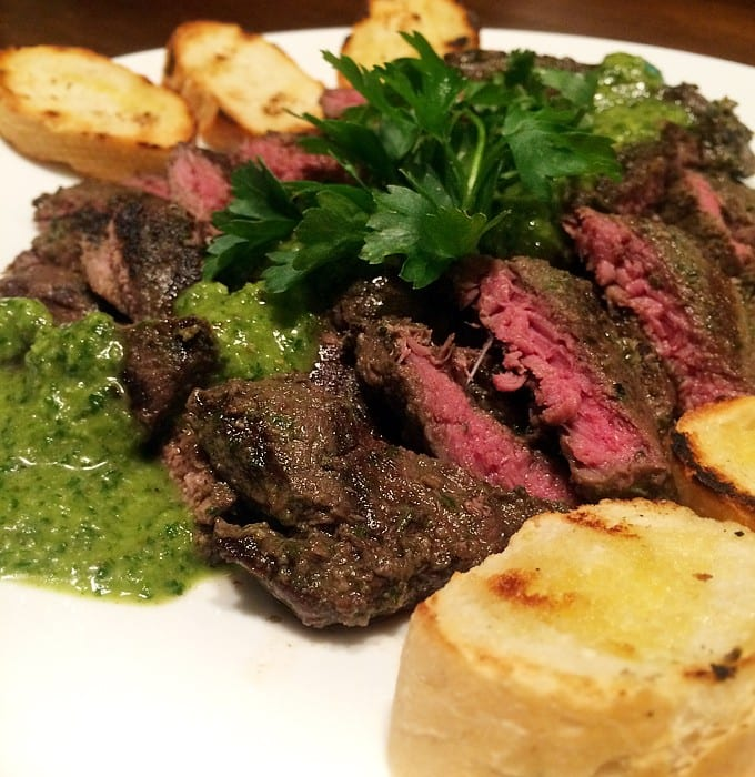 Chimichurri grilled elk steaks served with toasted sourdough baguette ...