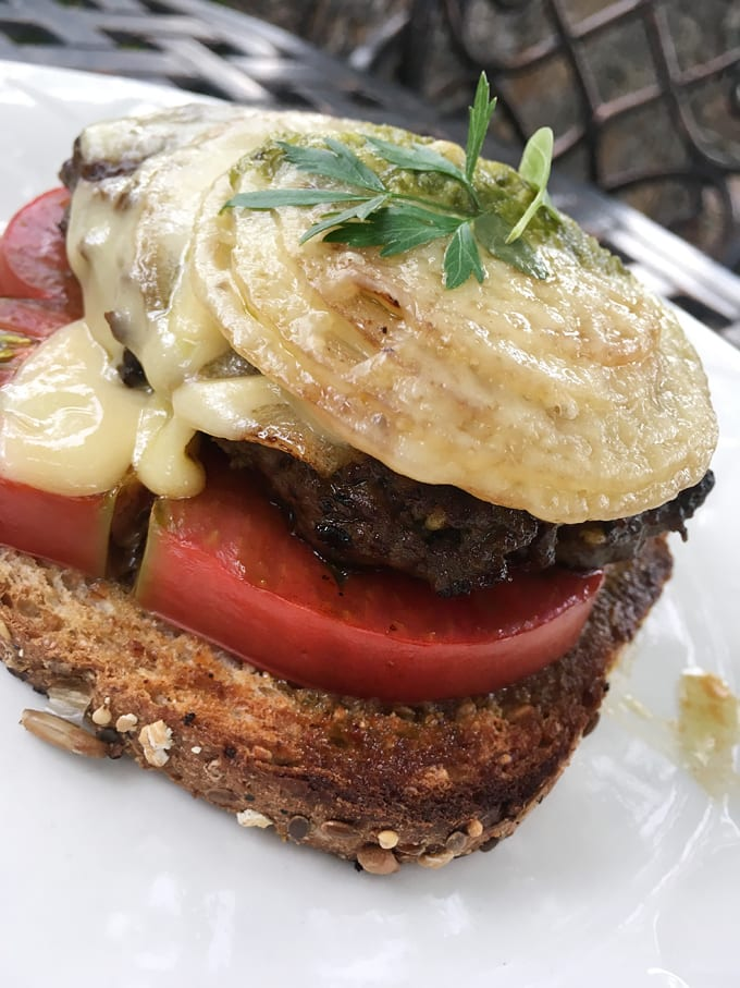Open-Faced Pesto Cheeseburgers with Grilled Onions
