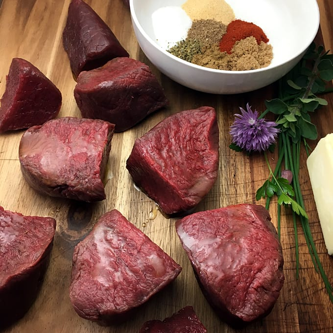 Seasoned Elk Steaks with Herb Butter